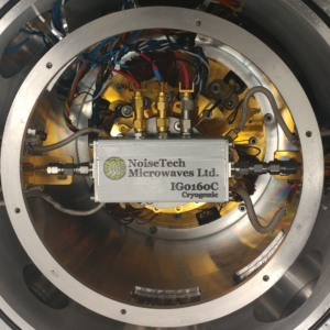Photo showing NoiseTech's cryogenic impedance generator in a cryostat